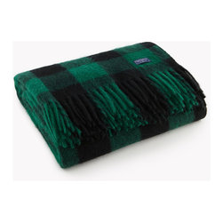Faribault Woolen Mill Co. - Buffalo Plaid Wool Throw, Green/Black - Based on the timeless buffalo check design, this lumberjack plaid pattern would make our fellow Minnesotan, Paul Bunyan proud. The 2x2 twill construction creates a distinctive diagonal pattern that brings out the intricacies of the design. This is your blanket if you're seeking an authentic outdoor look. Permanently moth-proofed, 100% pure wool.