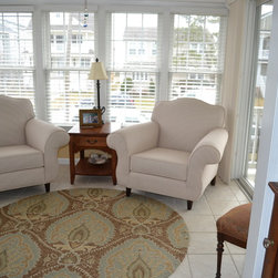 Furniture Reupholstery - This pair of armchairs was reupholstered in a cotton ticking stripe fabric for a beautiful home in Ocean City, NJ.