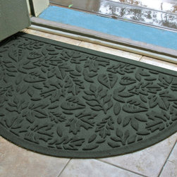 Frontgate - WATER & DIRT SHIELD ™ Fall Day Half-round Mat - Nonslip, rubber backing holds mat firmly in place. Crafted of durable polypropylene. Hoses off to clean. Made in the USA. Our WATER & DIRT SHIELD ™ Fall Day Half-round Mat boasts beautifully detailed leaf motif that traps and holds up to a gallon of water per square yard. A coarse texture and raised design scrapes mud and dirt off shoes and pet paws to keep floors clean and dry.  .  .  . .