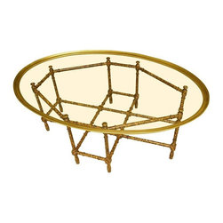 Pre-owned Baker Faux Bamboo and Glass Cocktail Table - A true Mid-Century classic, this glass cocktail table by Baker Furniture Company dates back to the 1960s (catalog illustration included!). Has a hardwood base in bamboo style with a faux tortoiseshell finish and beautiful brass edging that coordinates with the tortoiseshell base. It's made with Baker's exquisite craftsmanship and attention to detail. The tables glass top is excellent for showing off flooring or a rug and making a small area feel larger.