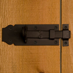 Iron Sliding Bolt - This slide bolt features a flat mounting plate with a notched spade detail on one end and a sleek handle. Add style and security to your gate or door.