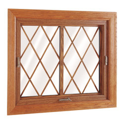"""Flip & Wash Windows - Interior view of Wellington Flip and Wash Window; shown in Country Oak with 5/8"""" Flat Diamond Grids."""