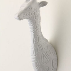 """View From Here Hook - Start your own little wall menagerie with this hook. The helpful enamel giraffe will hold your purses, coats, and scarves.Dimensions: 4.75""""H x 1""""W. Made of aluminum."""