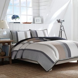 Nautica - Nautica Hayward Quilt - Sail away from reality while you sleep with the Nautica Hayward Quilt Collection. With a calming stream of pale blue, beige, and grey stripes on a pristine white base, the simple and classic bedding creates a tranquil look in your bedroom.