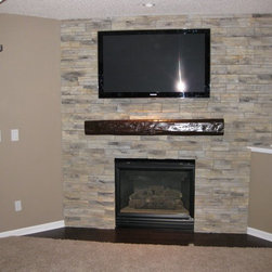 Fireplace Mantels - Simple can be stunning and the splash of contrast created by including this mantel shelf helps to really draw the eyes into the focal point of the room.