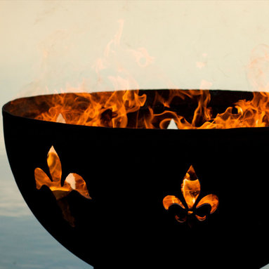 """Fire Pits - Great for Fall and Winter - The Fleur de Lis is a classic symbol of the French Monarchy and sets the standard for show casing your hospitality and elegance to your friends and family. This original design is made to order by Tennessee craftsman in the heartland of America. They are constructed from heavy duty 1/4"""" thick mild carbon steel and are the most durable steel fire pit made anywhere. The inner bowl has a high temperature resistant coating and comes with a 1 1/2"""" diameter rain drain. The outer iron oxide patina is maintenance free and the fire pit can be left outside in all weather conditions. Over time and use the patina will mature and darken a few shades and then remain permanent forever. Each unique fire pit is individually numbered by the artist on an attached brass plaque."""