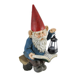 Reading Garden Gnome with Lantern Outdoor Statue - This wonderfully detailed garden gnome statue is sitting on a bench, reading a book, using a battery powered lantern for extra reading light. Made of cold cast resin, the gnome measures 18 inches tall, 11 inches wide and 7 inches deep. He's hand-painted, and shows great detail. The lantern opens from the bottom, allowing you to change out the battery when needed. This statue makes a wonderful gift for any gnome collector.