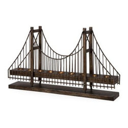 Suspension Bridge Candleholder - Perfect for anyone who loves architecture the Suspension Bridge Candleholder will make a dramatic addition to any room. This striking tabletop design crafted from durable metal features decorative details and a rich weathered bronze finish. It's designed to hold nine tea light candles. Bring this miniature suspension bridge replica into your home. This candleholder is ideally suited to eclectic or contemporary-style interiors. It stands 17.75 inches tall and measures 30.5 inches wide.