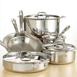 All-Clad - Copper Core 10-Piece Cookware Set - Kitchen connoisseurs will enjoy elegant design and high performance with All-Clad's 10-piece Copper Core Set. Copper Core combines the heat conductivity of copper with the cleaning ease of 18/10 stainless steel, making it a smart and versatile choice for the well-appointed kitchen. This 10-piece set--ideal for serious home cooks or experienced professionals--includes 8- and 10-inch fry pans, 2- and 3-quart saucepans with lids, a 3-quart saut pan with lid and an 8-quart stockpot with lid. Each piece in the set features heavy-duty five-ply construction designed for rapid and even heat distribution. Features: -10-piece stainless steel set with copper band detail.-Includes 8- and 10-inch fry pans, 2- and 3-quart saucepans with lids, 3-quart saut pan with lid, 8-quart stockpot with lid, care and use manual, and warranty information..-Heat-conducting copper core and five-ply construction.-Long polished stainless stay-cool handles are secured with sturdy, non-corrosive rivets.-Beautiful polished stainless lids fit evenly with the pan's edges to seal in flavor.-Made in the USA.-Stick-resistant 18/10 stainless steel interior.-Oven/stove safe up to 800 degrees F.-Dishwasher safe, but hand washing is recommended.-Rapid, even heating on any cooking surface.-Convenient capacity markings on each pan.-Collection: Copper-Core.-Distressed: No.-Country of Manufacture: United States.-Hardware Finish: Stainless Steel.-Powder Coated Finish: No.-Gloss Finish: No.-Material: Stainless Steel; Aluminum; Copper.-Base Material: Stainless Steel.-Hardware Material: Stainless Steel.-Number of Items Included: 10.-Non Toxic: Yes.-Scratch Resistant: No.-Rust Resistant: No.-Warp Resistant: No.-Chip Resistant: No.-Tarnish Resistant: No.-Stain Resistant: No.-Peel Resistant: No.-Nonreactive: Yes.-Non-Stick Surface: No.-Construction: 3-ply.-Oven Safe: Yes.-Freezer Safe: Yes.-Microwave Safe: No.-Dishwasher Safe: Yes.-Stove Safe: Yes.-Lids Included: Yes -Numbe