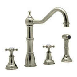 Rohl Perrin & Rowe U.4775X-STN Double Handle Kitchen Faucet - Soften your sink - but not your approach to dirty dishes - with the Rohl Perrin & Rowe U.4775X-STN Double Handle Kitchen Faucet. Crafted with durable solid brass in a soft satin nickel finish, this fixture is designed for installation with four faucet holes and ¼-turn ceramic disc valves. Two cross-style knob handles control a steady 1.8 gallon per minute flow, and the high-arched swivel spout provides clearance for large pots and pans. An insulated brass sidespray blasts debris from dishes. Limited lifetime warranty included. Product SpecificationsHandle style: KnobValve type: ¼-turn ceramic discFlow rate: 1.8 gallons per minuteSpout height: 8 inchesSpout reach: 9 inchesAbout RohlNamed for the family that founded it in 1983, Rohl is anchored in a tradition of family values, trust, integrity, and innovation. Since starting with its original pullout faucet, Rohl has continually expanded its product line, which now includes a variety of high-quality, classically differentiated faucets and fixtures. Each is crafted to Rohl's specifications for the home, hotel, or resort.
