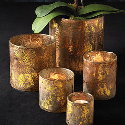Gilt Glass Candleholders - Set of 5 - Bright, warm gold in a distressed finish gilds your decor with a hint of high-end glow. The Gilt Glass Candleholders, a striking set of five simple cylinders in gradated sizes, offers the inviting welcome of an instantly-coordinated coffee-table arrangement or mantelpiece vignette. Use as vases, pillar holders, or simple decorative vessels for a lovely transitional look.