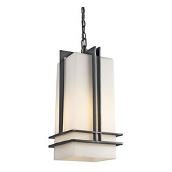 Kichler 1-Light Outdoor Fixture - Black Exterior - One Light Outdoor Fixture. Contemporary style at its finest, this lighting outdoor hanging light features an elongated shape and clean, modern lines for an updated look. From the Tremillo collection, it features an elegant painted black finish and coordinating satin etched cased opal glass shade that pulls the look together. Energy efficient compact fluorescent lamp may be used: not included.
