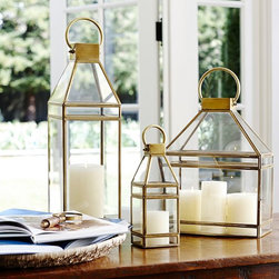 Meredith Brass Lantern - I love the ambience that lanterns provide, and these brass versions would tie in nicely with a British Colonial room.