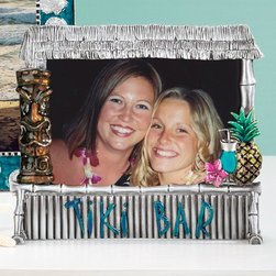 "Exposures - Beach Retreat Frame Tiki Bar - Overview This whimsical frame is almost as much fun as a vacation itself. Show off your beach vacation photos inside this festive pewter frame, featuring shimmering colored enamel and raised pewter accents. Makes a perfect gift to remind your fellow travelers of the great memories you've shared.  Features Pewter frame Silver-tone frame with colored enamel accents Table display only Specifications Frame measures 5-3/4""H x 6""W and holds a 4"" x 6"" photo"