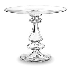 Cero Medium Stand - Sparkling in clear Romanian glass worked into a variety of spindle knobs and curves, the Cero Medium Stand is ideal for elevating after-lunch sweets or exemplary creations above the tabletop. When paired with the matching dome, it also makes a lovely little decorative terrarium, but the intention for elegant dining is delightfully apparent in this handcrafted accessory.