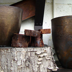 Bronze Egg Planters - These bronze planters have an ancient look to them. The hammered exterior will create a beautiful patina over time.