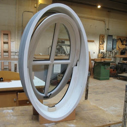 Custom Windows - An oval casement window that pushes out like an awning and pivots on its center? Sure, Versatile can do that.