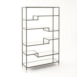 Tiered Tower Bookcase - A metal frame with mirrored glass shelves is taken up a notch with tiered shelving for visual interest. I love how this prompts you to consider staging items both tall and short.