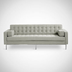 "Gus* - Spencer Sofa - Spencer Sofa  by Gus Modern   At A Glance:   The mid-century inspired Spencer Sofa takes many of the styling cues made famous by designers like Florence Knoll and places them seamlessly within our modern context. The Spencer Sofa features classic blind-tufted seat and back cushion upholstery with a stainless steel inset base for a subtle change of pace from the design norm. Spencer comfortably fits 3 and is perfect for social gatherings.  What's To Like:  When we hear the name ""Spencer,"" we think ""dependable, good-looking, and well-informed."" That's a good way to describe the Spencer Sofa. It's awfully sturdy, and has looks to die for. We're not sure where the ""well-informed"" part fits in.Here's a modern sofa that will work well in almost any setting, and with almost any kind of decor around it. You want flexible? Here it is.  What's Not to Like:   The only downside of the Spencer Sofa is its price. This kind of well-d"