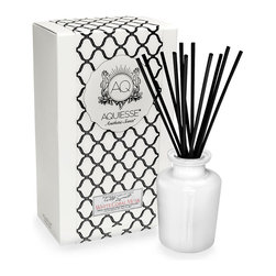 White Coral Musk Diffuser - Surprising black reeds bloom from a stark, formal white glass bottle to make up the White Coral Musk Diffuser. This attractive, formal home decor element holds a sweet reserve of fragrant oil at its heart, filling your room with an elegant mix of clean, pale musk and wood notes; the liquid subtleties of sweet jasmine are balanced by the drying tones of sage.