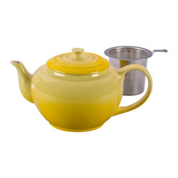 Le Creuset - Le Creuset Teapot With Steel Infuser - For a truly memorable cup of tea, whole-leaf loose varieties offer a full spectrum of flavors and infusions. The classic style of this teapot fits into any kitchen, while the stainless steel insert makes it easy to add loose leaves to hot water for steeping and pouring the perfect cup. Its 1-quart capacity is perfect for entertaining family and friends.