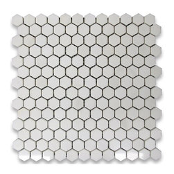 Thassos White Greek Marble Hexagon Mosaic Tile, Polished - My kitchen currently lacks a backsplash, and being that the surface will literally sit between my black/brown countertops and my new white cabinetry, I think it's essential that it tie the two areas together. I love classic white subway tile, but I am thinking of these hexagonal white tiles instead. The white will complement the cabinets nicely, and dark gray or black grout is sure to tie in the countertops. Also, the retro feel of the hexagon shape lends a nod to the industrial flair that I'm after.