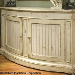 """Habersham - Habersham Camden 64 x 18 Sideboard - It all started in the small North Georgia town of Clarkesville. It was 1969 and Habersham founder Joyce Eddy had just been given the chance to operate a small antique shop located above an old laundromat. This was just the opportunity a woman of Joyce's vision and energy would turn into the perfect blend of utility artistry and soul. Looking for ways to make her antique business more profitable she began crafting small decorative purses from vintage wooden cigar boxes. They were totally unique and they were an instant hit. Joyce named her new venture Habersham Plantation after Georgia's Habersham County and the plantations for which the area was known. The ideas just kept coming. One day Joyce was driving by a local textile company and spotted a large pile of old discarded wooden spools. Those spools were soon crafted into candleholders towel racks and folk art items. With the help of her sons and other family members Joyce expanded Habersham's offerings to include handcrafted furniture reflecting the American Country designs of the early 17th and 18th centuries. As word spread and production demands grew Joyce enlisted the help of woodworkers from her North Georgia region. This area had been a center for cabinetmaking since the early 1800s and the master craftsmen were well-schooled in the time-tested woodworking and joinery techniques that matched Joyce's sense of style and function. She even designed her factory to work just as the 18th century cabinetmakers did with individual artisans hand-finishing signing and dating each piece of furniture they crafted. Today Habersham still leads the way in the fine art of furniture design. So much so that in addition to their product line a new """"whole home"""" concept is finding its way into some of the finest dwellings in the country. Custom kitchen bath and other cabinetry designs offer rich opulent finishes and blend seamlessly with rooms of casual elegance all enhancing toda"""