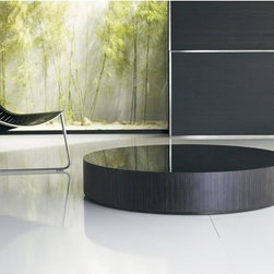 Luxo by Modloft - Berkeley Low Coffee Table - Synonymous with modern luxury and invites consumers to revel in a contemporary design-forward lifestyle. Luxo by Modloft offers consumers an entire lifestyle in which to live boldly and beautifully via its furniture collections and accessories. Made in Brazil using only environmentally sustainable materials, Luxo by Modloft delivers uncompromising quality with undeniable flair. Well made. Well priced. Well done. Features: -Round wood base with glass top.-Brazilian sustainable wood construction.-Berkeley collection.-Please note: This item cannot be cancelled after purchase due to the custom nature of the product.-Collection: Berkeley.-Distressed: No.Dimensions: -Dimensions: 8'' H x 35'' W x 35'' D.-Overall Product Weight: 70lbs.