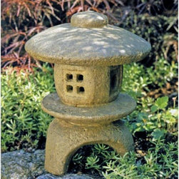 Campania International - Mini Pagoda Garden Statue - OR-35-GS - Shop for Statues and Sculptures from Hayneedle.com! There's nothing like a genuine hand-crafted cast stone garden artifact. Heavy and durable this humble-looking Mini Pagoda Garden Statue represents the highest level of design construction and materials. It stands a full 11 inches tall and like any stone it will age naturally and gracefully lasting a lifetime. Cast and finished individually by artisans no two are exactly alike. Choose from a variety of hand-applied finishes.About Campania InternationalEstablished in 1984 Campania International's reputation has been built on quality original products and service. Originally selling terra cotta planters Campania soon began to research and develop the design and manufacture of cast stone garden planters and ornaments. Campania is also an importer and wholesaler of garden products including polyethylene terra cotta glazed pottery cast iron and fiberglass planters as well as classic garden structures fountains and cast resin statuary.Campania Cast Stone: The ProcessThe creation of Campania's cast stone pieces begins and ends by hand. From the creation of an original design making of a mold pouring the cast stone application of the patina to the final packing of an order the process is both technical and artistic. As many as 30 pairs of hands are involved in the creation of each Campania piece in a labor intensive 15 step process.The process begins either with the creation of an original copyrighted design by Campania's artisans or an antique original. Antique originals will often require some restoration work which is also done in-house by expert craftsmen. Campania's mold making department will then begin a multi-step process to create a production mold which will properly replicate the detail and texture of the original piece. Depending on its size and complexity a mold can take as long as three months to complete. Campania creates in excess of 700 molds p