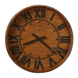 Howard Miller - Howard Miller Wine Barrel Wall Clock In Distr - Applied metal band to resemble an authentic oak wine barrel. Applied aged metal Roman numerals and hands. Metal ring. Rounded hour markers. Quartz, battery operated movement. Distressed Heirloom Oak. Hardwoods and veneers. 25 in. Diameter x 4 in. D