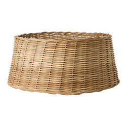 Wicker Tree Skirt - A common theme in Scandianvian homes is to put the Christmas tree on display in a beautiful basket or bucket. I love this wicker basket from Terrain; it will definitely add a bit of unexpected charm to your tree.