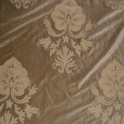 Crewel Fabric World by MDS - Crewel Fabric Konark Tan on Tan Brown Cotton Velvet- Yardage - Inspiration: Konark is a pattern inspired by a Sun Temple built in 1250 AD in the village of Konark History: Konark was developed artisans in India The Konark Sun Temple takes the form of a huge chariot for the sun god Surya, with 12 pairs of stone-carved wheels and a team of seven galloping horses. The temple also symbolizes the passage of time, which is under the sun god's control. The seven horses, which pull the sun temple eastwards towards the dawn, represent the days of the week. The 12 pairs of wheels represent the 12 months of the year and the eight spokes in each wheel symbolize the eight ideal stages of a woman's day.