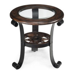 Magnussen Winthrop Round End Table - Nautical design gets a luxurious upgrade in this Magnussen Winthrop Round End Table. With its glass insert top, distressed ironelle frame, and ship's wheel accent, this end table gets noticed. Sized just right to stand by your sofa or chair, this end table is made of hardwood solids with a deep aged walnut finish. The wood framed, round clear glass top has a generous beveled edge for sparkle. This end table stands on a curved metal frame detailed with the mini ship wheel. About Magnussen FurnitureFrom its beginning as a small furniture company in Ontario, Canada, Magnussen Furniture has evolved into a full-line furniture resource with offices in Canada, the United States, and the Far East. Their business is creating furniture designs of exceptional style, value, and beauty. They produce these designs in partnership with manufacturing partners around the world that meet exacting standards for superior quality at the best possible value.