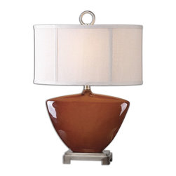 Uttermost - Uttermost Ceadda Rust Red Lamp 26178-1 - Ceramic base finished in a high gloss rust red glaze accented with brushed nickel plated details. The oval drum shade is a crisp light beige linen fabric. Due to the nature of fired glazes on ceramic lamps, finishes will vary slightly.