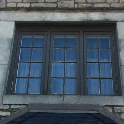Window Replacement - Original wood triple casement window with single glazed glass.