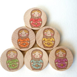 Wooden Matryoshka Memory Game by Wee Waldorf - These gorgeous hand-stamped, hand-colored wooden discs would not only be adorable on display, but help your little one with memory and recognizing his colors.
