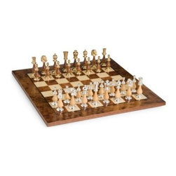 Elegant Gold, Silver & Wood Chess Set - Beautifully handcrafted by Italian artisans for the utmost in sophistication the Cambor Games Elegant Gold Silver and Wood Chess Set features gorgeous chess pieces that are truly works of art. Each piece is made from a combination of brass and wood. Lighter maple wood is paired with a silver plated head for one player while gold plated tops add a dark luster to the walnut wood for the other side. These visually stunning pieces pair well with your choice of two handsome boards. The Exotic Italian Board features inlaid 2-inch elm and root wood squares with a unique finish for years of durable beauty. If you desire storage for your pieces the Regal Alabaster Chess Cabinet features a convenient compartment topped by a board that combines antique finished worm wood with creamy Italian alabaster for luxurious style.About Cambor GamesNew Jersey-based Cambor Games has spent the last 30 years developing product lines to address a variety of classic gaming needs. The company offers chess sets backgammon boards poker equipment dominoes mahjong tiles and more. From traditional designs to novelty themed items value-priced beginner sets to high-end collectors' dreams Cambor Games has the game equipment you need to have years of fun with close friends or bitter rivals.