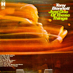 "Adonis Collection - Adonis Collection | Tony Bennett, framed album - Tony Bennett, ""Just One of Those Things,"" framed record album. Released in 1969 by Harmony Records. Record is included but not assessed for condition. Consider also displaying the reverse or interior (if applicable) album art; we will frame the front artwork unless we believe the reverse to display more attractively. Fine condition, note some cover discoloration, markings and/or wear and tear; these inform the vintage quality of the display. Quality framed in wood with non-glare UV protection glass. Cover photo by Tom Monaster. Monaster is a noted rock photographer, of artists such as Jimi Hendrix, Joan Baez, Bob Dylan, Janis Joplin, Jefferson Airplane, The Rolling Stones, The Doors and others. It appears that Tony Bennett was destined to be hip with the young folk by being in this photographer's company."
