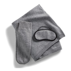 Frontgate - Cashmere Jersey Travel Set with Socks - The collection fits neatly into a cashmere zippered bag that serves as a travel pillow or pillowcase. Knit in 100% premium 12-gauge cashmere. Two-ply Mongolian cashmere provides unmatched softness and comfortable, year-round warmth. Offers lightweight warmth without the bulk. One-size-fits-all socks feature ribbed cuffs. Make travel feel luxurious again with our Cashmere Travel Set. Sized to fit in your carry-on, it contains everything you need for comfort on a plane or train, or in a car: a soft throw to ward off the chill, a soothing eye mask to block harsh light, and a pair of socks to retain heat and warm your feet..  . .  .  . Arrives in an elegant gift box . Dry clean . Imported .