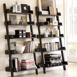 "Studio Wall Shelf, Black - Our shelf is precision engineered to be stronger and last longer than any other. Its deep shelves offer exceptionally generous storage space, and self-leveling feet and keyhole mounts at the top provide stability. 34"" wide x 18"" deep x 75"" high Wood swatches, below, are available for $25 each. We will provide a merchandise refund for wood swatches if they're returned within 30 days. Simple assembly. Catalog / Internet Only. View our {{link path='pages/popups/fb-media.html' class='popup' width='480' height='300'}}Furniture Brochure{{/link}}."