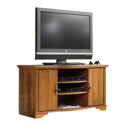 Sauder - Harvest Mill Entertainment Credenza in Abbey - 2 Adjustable shelves hold audio and video equipment. Storage area behind doors. Holds 40 cardboard case VHS tapes, 36 oversized VHS tapes, 108 CDs or 84 DVDs. Accented with solid wood detailing. Made of engineered wood. Assembly required. 47 in. W x 19 in. D x 24 in. H