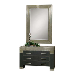 Uttermost Razi Metal Drawer Chest - Supple, black faux leather finish accented by industrial silver metal sheeting and rivet accents. Supple, black faux leather finish accented by industrial silver metal sheeting with champagne stain and rivet accents. Shown with mirror #07638.