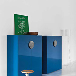 Contemporanea Sideboard - Comfortable internal spaces and wide surfaces enhance the curves of the handle. A sense of movement is given by a couple of semicircles, the painted or a tinized metal emphasizes the beauty of the materials. The top suggests balance and air to the external objects in a unique volume of shapes. Back Panel: Wooden, Mirror, LED Lit Frosted Glass. Made in Italy.