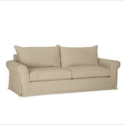 PB Comfort Roll-Arm Grand Sofa with Knife-Edge Cushion Slipcover, Ticking Stripe - Designed exclusively for our versatile PB Comfort Grand Collection, these soft, inviting slipcovers retain their smooth fit and remove easily for cleaning. Grand Armchair with Box Back Cushions shown. Care varies depending on {{link path='pages/popups/fab_leather_popup.html' class='popup' width='720' height='800'}}fabric type{{/link}}. This item can also be customized with your choice of over 90 custom fabrics and colors. For details and pricing on custom fabrics, please call us at 800.840.3658 or click Live Help above. All slipcover fabrics are hand selected for softness, quality and durability. This is a special-order item and ships directly from the manufacturer. To see fabrics available for Quick Ship and to view our order and return policy, click on the Shipping Info tab above. Watch a video about our exclusive {{link path='/stylehouse/videos/videos/pbq_v36_rel.html?cm_sp=Video_PIP-_-PBQUALITY-_-SUTTER_STREET' class='popup' width='950' height='300'}}North Carolina Furniture Workshop{{/link}}.