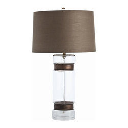 Arteriors - Garrison Cylinder Lamp - This lamp's molded glass cylindrical base cinched with two vintage brass rings brings to mind an antique lantern or found object. The brown linen drum shade matches the brass rings, both lending an earthy quality that balances the airy, transparent glass. This unique piece would add subtle character to any contemporary style room.