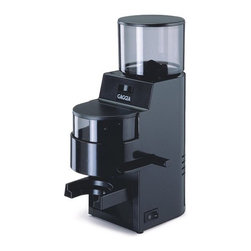 Gaggia - MDF Grinder in Black - This compact grinder with sleek design is a great addition to any kitchen. This unit will dispense a consistent amount of ground coffee every time you brew. The powerful 50mm tempered steel grinding burrs create an even grind for ultimate flavor extraction. Choose from 34 different settings for espresso, drip coffee, or French press! The perfect cup is always at your fingertips! Features & Benefits: -Black finish -Heavy Duty 120 Watt Motor -Low Speed and Low Static Grinder -34 Grind Settings -50mm Tempered Steel Grinding Burrs -Impact resistant plastic housing -10oz. Large capacity bean hopper -Dosing grinder with pull lever action -Ground coffee container -Please note that most grinders are pre-tested and coffee grounds may be found in the grinder as a result. -100 Watts / 120 Volts -Made in Italy -Dimensions: 11.5H x 4.5W x 8.5D