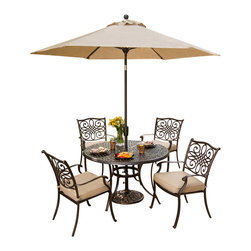 """Hanover - 5 Piece Dining Set, With Umbrella and Stand - The traditionally designed Hanover Traditions 5PC-SU 5-piece patio set beautifully transforms any backyard into an elegant outdoor dining area with its superior quality and deep comfort feel. Included in this set are four deep cushioned dining chairs and a 48"""" round dining table along with an umbrella and base. All items have alumnicast frames featuring heavy gauge aluminum-alloy extrusions with uniquely supported inner walls. These frames will remain rust free for life. Even the Champaign-colored cushions are built to last, ensuring deep comfort while maintaining their original full shape. The fabric of these pillows and cushions are also specifically designed, woven, and treated for quick drying while resisting stains and UV harm. Designed to last, this 5-piece outdoor dining set will surely provide you with a natural alternative to entertaining indoors. Minor assembly is required."""
