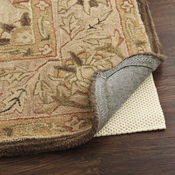 Ballard Designs - Cushioned Rug Pad for Hard Floors - Provides ultra soft cushion. Extends the life and beauty of fine rugs. Protects floors & rugs. Makes vacuuming easier. Hand washable. Give fine rugs a delicate soft step while guarding against slippage with our Cushioned Rug Pad. The ultimate in comfort, it's made of polyester scrim coated with a spongy layer of PVC foam to be antimicrobial, mold and mildew resistant. Designed to use over hard floors and won't stain, discolor or stick to floors or rugs. Trims easily with scissors for a perfect fit.Cushioned Rug Pad Features:. . . . . Trims easily for a custom fit.