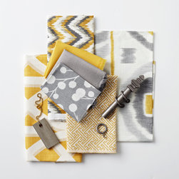 Prospect Kitchen - Prints in bright yellows with soft grays create an energizing atmosphere.
