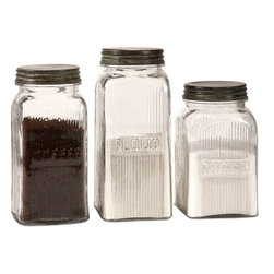 "Imax Worldwide Home - Dyer Glass Canisters - Set of 3 - With a vintage flair, the Dyer glass canisters hold flour, sugar and coffee on any countertop or pantry shelf in style. Food safe.; Materials: 90% Glass, 10% Iron; Country of Origin: India; Weight: 5.5 lbs; Dimensions: 7.25-8.25-9.25""H x 4""W x 4"""